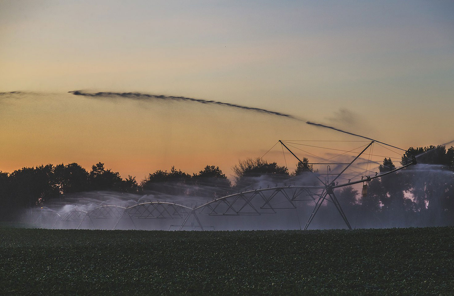 Photo of agriculture crop irrigation system spraying water